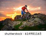 cyclist riding the mountain... | Shutterstock . vector #614981165