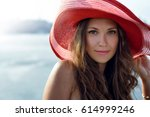 beautiful girl in a red hat... | Shutterstock . vector #614999246