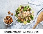 fresh caesar salad in white... | Shutterstock . vector #615011645