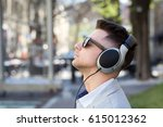 young businessman listening to... | Shutterstock . vector #615012362