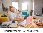 worried mother holding baby and ... | Shutterstock . vector #615038798