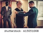 tailor measuring client for... | Shutterstock . vector #615051008