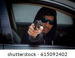Thief in a Black Mask and Black Glasses.  Car Thief Inside the Modern Car. Safety in life and property - stock photo