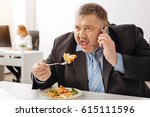 Small photo of Overloaded ambitious employee cannot have a proper meal