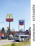 Small photo of SPRINGFIELD, OR - MARCH 31, 2017: McDonalds and Chevron gas station signs directly next to each other in the Gateway area of Springfield Oregon.