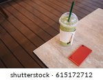 coffee cup and smartphoneon... | Shutterstock . vector #615172712