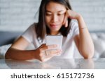 relaxed asian woman use smart... | Shutterstock . vector #615172736