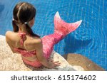 mermaid girl with pink tail on... | Shutterstock . vector #615174602