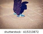little boy playing hopscotch on ...   Shutterstock . vector #615213872