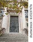 Small photo of Establishing shot of brownstone building from stairs