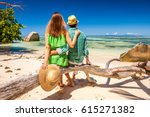 Stock photo couple relaxing on a tropical beach anse source d argent at seychelles la digue 615271382