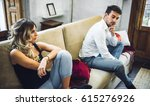 young couple sitting on sofa... | Shutterstock . vector #615276926