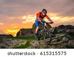 cyclist riding the mountain... | Shutterstock . vector #615315575