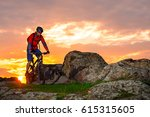cyclist riding the mountain... | Shutterstock . vector #615315605