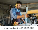 handsome bearded woodworker in... | Shutterstock . vector #615325208