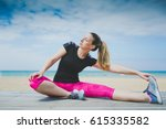 runner woman stretching legs