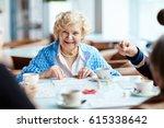 cheerful elegant looking... | Shutterstock . vector #615338642