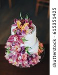 a two level white wedding cake... | Shutterstock . vector #615351425