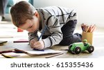 little kid drawing sketching... | Shutterstock . vector #615355436