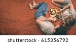 young couple is lying in bed... | Shutterstock . vector #615356792