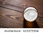 mug of beer on an old wooden... | Shutterstock . vector #615375506
