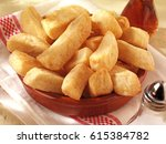 chunky fried potato chips or... | Shutterstock . vector #615384782