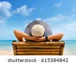Woman In Hat Relaxing On Beach  ...