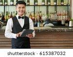 portrait of smiling vietnamese... | Shutterstock . vector #615387032