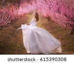 eautiful girl in a pink dress...   Shutterstock . vector #615390308