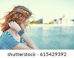 sad redhead woman looking away... | Shutterstock . vector #615429392