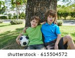 hugging brothers sitting under... | Shutterstock . vector #615504572