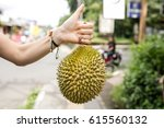 close up durian on woman hands | Shutterstock . vector #615560132