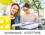girls studying together at park.... | Shutterstock . vector #615577658