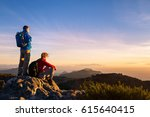 couple of hikers with backpacks ... | Shutterstock . vector #615640415