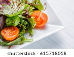 fresh salad of cherry tomatoes  ... | Shutterstock . vector #615718058