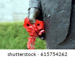 Poppies In A Statue Hand At Th...