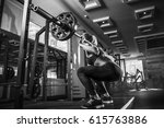 young sexy girl in the gym... | Shutterstock . vector #615763886
