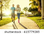 man and woman exercising and... | Shutterstock . vector #615779285