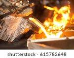 Operator Pouring Molten Metal...