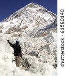 Hiker stands in the Khumbu Icefield at the basecamp of Mt Everest, Nepal. - stock photo