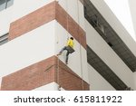 painting the building sprinkle...   Shutterstock . vector #615811922