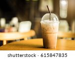 cold iced coffee on wooden... | Shutterstock . vector #615847835