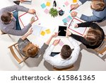 team sitting behind desk ... | Shutterstock . vector #615861365