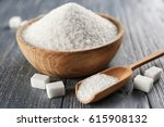 bowl and scoop with white sand... | Shutterstock . vector #615908132