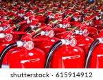 red fire extinguishers... | Shutterstock . vector #615914912