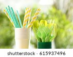 plastic ware on table outdoors | Shutterstock . vector #615937496