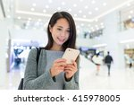 woman use of mobile phone in... | Shutterstock . vector #615978005