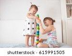 two cute siblings sisters play... | Shutterstock . vector #615991505