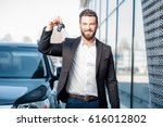 happy buyer holding keys near... | Shutterstock . vector #616012802