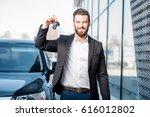 happy buyer holding keys near... | Shutterstock . vector #616012802